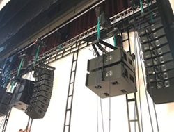 "The Left, Center, and Right screen channels were delivered by three ""hangs"" consisting of eight QSC WL2102w line arrays with two WL218-sw subwoofers suspended behind the screen"