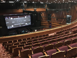 Twenty-three QSC SR-1590 surround loudspeakers were suspended from truss above the audience for Dolby Atmos immersive sound